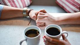 Two hands being held over coffee